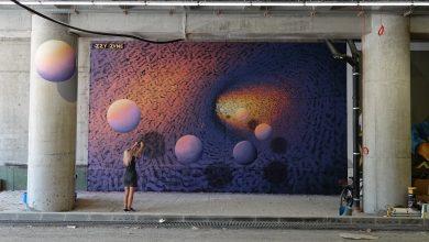 """Photo of foto   """"Lumea cosmică"""" a ei cucerește tot mai mult. iZZY iZVNE a creat o pictură murală într-un tunel creativ din Timișoara"""