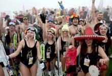 Photo of foto | Festivalul alpin Boogel-Woogel din Rusia: Locul unde oamenii schiază în costume de baie